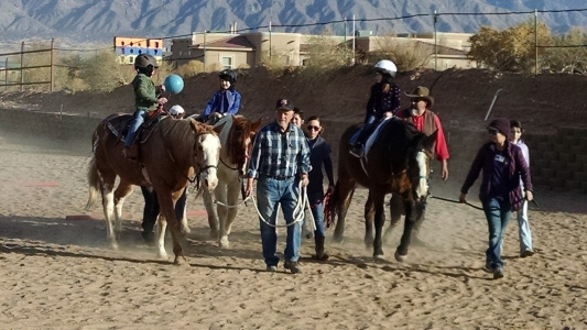volunteers and riders at loving thunder therapeutic riding